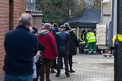 © Licensed to London News Pictures. 02/02/2021. London, UK. Members of the public queue up at a Covid-19 testing centre in the high risk area of Hanwell, West London where the South African mutation has spread. Staff prepare a Covid testing centre in Hanwell as the Covid-19 South African variant spreads across London. Yesterday, two people tested positive in Woking, Surrey for the South African variant by community transmission with no links to South Africa as 80,000 people in the South East will be offered urgent Covid-19 tests.  Earlier, Health Minister Matt Hancock urged residents in high risk areas to take extra special precautions . Photo credit: Alex Lentati/LNP