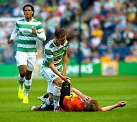22/07/14 UEFA CHAMPIONS LEAGUE 2ND QUALIFYING ROUND 2ND LEG<br /> CELTIC v KR REYKJAVIK<br /> BT MURRAYFIELD STADIUM - EDINBURGH<br /> Celtic ace Stefan Johansen (left) checks on Baldur Sigurdsson after a clash