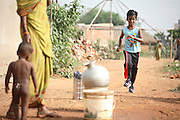 Budhia Singh, (right) 6, the famous Limca World Record marathoner, is training on the roads near his home in Salia Sahi slum (pop. 30.000) of Bhubaneswar, the capital of Orissa State, on Sunday, May 18. On May 1, 2006, Budhia completed a record breaking 65 km run from Jagannath temple, Puri to Bhubaneswar. He was accompanied by his coach Biranchi Das and by the Central Reserve Police Force (CRPF). On 8th May 2006, a Government statement had ordered that he stopped running. The announcement came after doctors found the boy had high blood pressure and cardiological stress. As of 13th August 2007 Budhia's coach Biranchi Das was arrested by Indian police on suspicion of torture. Singh has accused his coach of beating him and withholding food. Das says Singh's family are making up charges as a result of a few petty rows. On April 13, Biranchi Das was shot dead in Bhubaneswar, in what is believed to be an event unconnected with Budhia, although the police is investigating the case and has made an arrest, a local goon named Raja Archary, which is now in police custody. **Italy and China Out**