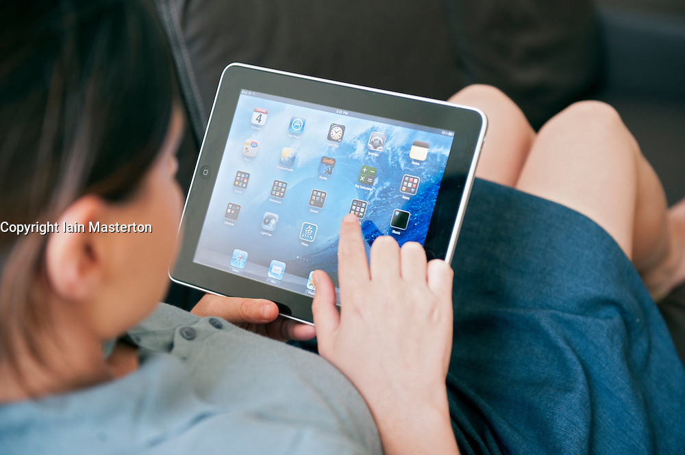 close up of woman using iPad digital tablet computer