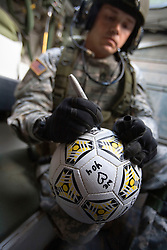 A member of the 1st Infantry, 17th Regiment, sings a football while helping Iraqi forces patrol in western Mosul, Iraq, Dec. 16, 2005. This is part of an effort to provide security in preparation for Iraq's first post-Saddam parliamentary elections. The western sector is home to Mosul's primarily Sunni population, which has been resistant to the American presence in Iraq.