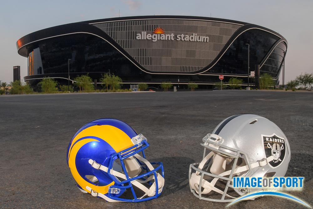 The Los Angeles Rams and Las Vegas Raiders helmets sit outside of of Allegiant Stadium, Monday, Sept. 14, 2020, in Las Vegas. (Dylan Stewart/Image of Sport)