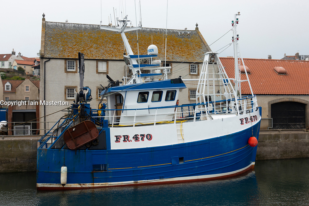 View of fishing trawler in harbour at Pittenweem village in the East Neuk of Fife in Scotland, UK