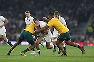 Jonny May of England charging towards Tevita Kuridrani of Australia and Will Genia of Australia. Rugby World Cup 2015 pool A match, England v Australia at Twickenham Stadium in London, England  on Saturday 3rd October 2015.<br /> pic by  John Patrick Fletcher, Andrew Orchard sports photography.