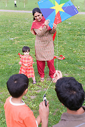 Young family in the park flying a kite,