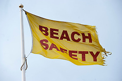 Cleethorpes Lincolnshire East Coast. Yellow life guard beach safety flag..1 July 2012.Image © Paul David Drabble