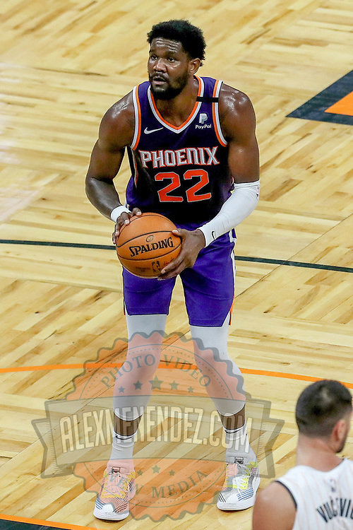 ORLANDO, FL - MARCH 24: Deandre Ayton #22 of the Phoenix Suns attempts a shot against the Orlando Magic at Amway Center on March 24, 2021 in Orlando, Florida. NOTE TO USER: User expressly acknowledges and agrees that, by downloading and or using this photograph, User is consenting to the terms and conditions of the Getty Images License Agreement. (Photo by Alex Menendez/Getty Images)*** Local Caption *** Deandre Ayton