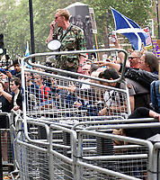 Laurence Fox addressing the crowd outside Downing Street during the anti-lockdown march 'Unite for Freedom' while shouting on a mega-phone against Boris Johnson & the Government.photo by Krisztian Elek