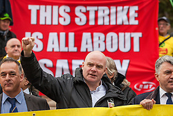 © Licensed to London News Pictures. 01/11/2016. London, UK. RMT General Secretary Mick Cash raises his fist in defiance at a protest against Southern Rail's plans to scrap guards on trains. A new wave of strike action over the long-running dispute is set to begin on Friday 4 November. Photo credit: Rob Pinney/LNP