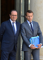 French President Francois Hollande and Minister of the Economy, Industry and the Digital Sector Emmanuel Macron after the last cabinet meeting before the government's annual summer vacation at the Elysee Palace, in Paris, France on July 30, 2015. Photo by Christian Liewig/ABACAPRESS.COM