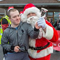 Brendan Jones from St Clares School rings the bell for Santa Claus
