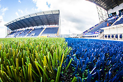A landscape image taken with a fish-eye lens showing the new plasctic pitch work at The Falkirk Stadium, with the new pitch work for the Scottish Championship game v Morton. The woven GreenFields MX synthetic turf and the surface has been specifically designed for football with 50mm tufts compared with the longer 65mm which has been used for mixed football and rugby uses.  It is fully FFA two star compliant and conforms to rules laid out by the SPL and SFL.<br /> ©Michael Schofield.