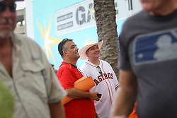 August 29, 2017 - St. Petersburg, Florida, U.S. - WILL VRAGOVIC   |   Times.Caleb Wines, of Dickenson, Tex., center in hat, and Michael Furtado, left, wait for the doors to open before the game between the Texas Rangers and the Houston Astros at Tropicana Field in St. Petersburg, Fla. on Tuesday, Aug. 29, 2017. Wines is in the US Navy, currently stationed in Port Canaveral, has family in the Houston area. ''Almost everyone has lost their homes,'' he said, ''It is what it is, it's Mother Nature. (Credit Image: © Will Vragovic/Tampa Bay Times via ZUMA Wire)