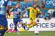Oxford United midfielder (on loan from Sheffield United) Ricky Holmes) (12) is fouled by Wycombe Wanderers midfielder Dominic Gape (4) during the EFL Sky Bet League 1 match between Wycombe Wanderers and Oxford United at Adams Park, High Wycombe, England on 15 September 2018.