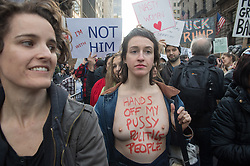 November 12, 2016 - New York, New York, U.S. - BRIE RUAIS of Brooklyn marches topless as  thousands of people rally and march to Trump Tower to protest president-elect Trump. (Credit Image: © Bryan Smith via ZUMA Wire)