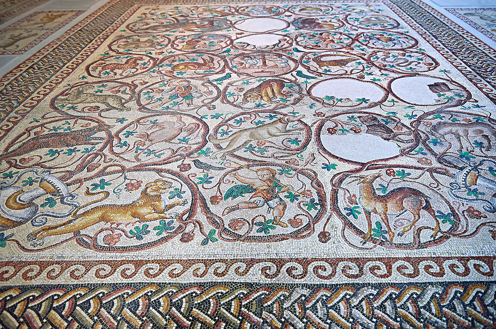 Roman mosaic of an early Christian church floor from Qabr Hiram, Lebanon, 575 AD. Marble blocks and glass paste cubes. This mosaic was designed to follow the layout of the church which had three naves. It depicts God through images of his creation: rural activities, fruit, animals with representations of the months, seasons and winds. The inscription indicates that the basilica was dedicated to St. Christopher and was built in 575 AD.. Inv 32230-2236, Louvre Museum, Paris .<br /> <br /> If you prefer to buy from our ALAMY PHOTO LIBRARY  Collection visit : https://www.alamy.com/portfolio/paul-williams-funkystock/roman-mosaic.html - Type -   Louvre    - into the LOWER SEARCH WITHIN GALLERY box. Refine search by adding background colour, place, museum etc<br /> <br /> Visit our ROMAN MOSAIC PHOTO COLLECTIONS for more photos to download  as wall art prints https://funkystock.photoshelter.com/gallery-collection/Roman-Mosaics-Art-Pictures-Images/C0000LcfNel7FpLI .