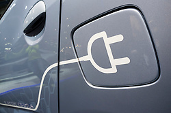 Detail of symbol on electric car for plug-in recharging at Paris Motor Show 2012