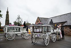 © Licensed to London News Pictures . 14/09/2018. Salford, UK. Horse drawn hearses used for the four coffins . The funerals of Demi Pearson , Brandon Pearson , Lacie Pearson and Lia Pearson , at St Paul's Church in Walkden . Demi , Brandon , Lacie and Lia were aged 15 , eight , seven and three respectively when their home was set on fire as they slept . Zak Bolland and David Worrall were handed four life sentences for their murders . Photo credit: Joel Goodman/LNP