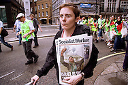 woman carrying socialist worker newspaper at the Anti-war march, 22nd July, 2006, london, UK