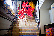 """Oct. 7, 2009 -- BANGKOK, THAILAND:  """"Ladyboys"""" at the Mambo Cabaret in Bangkok, Thailand, run up the stairs to the stage at the opening of the show. The performers at the Mambo Cabaret in Bangkok, Thailand are all """"Ladyboys,"""" or kathoeys in Thai. Recognized as a third gender, between male and female, they are born biologically male but live their lives as women. Many kathoey realize they are third gender in their early teens, some only as old 12 or 13. Kathoeys frequently undergo gender reassignment surgery to become women. Being a kathoey in Thailand does not carry the same negative connotation that being a transgendered person in the West does. A number of prominent Thai entertainers are kathoeys. Photo by Jack Kurtz / ZUMA Press"""