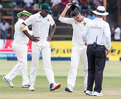 Zimbabwe captain Graeme Cremer (R) with test debutant Carl Mumba (L) during the 100th test match played by Zimbabwe in a match with Sri Lanka at Harare Sports Club 29 October 2016.