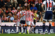 Charlie Adam of Stoke City holds his hand to his head as he receives a red card from referee Michael Oliver. Barclays Premier League match, Stoke city v West Bromwich Albion at the Britannia stadium in Stoke on Trent, Staffs on Saturday 29th August 2015.<br /> pic by Chris Stading, Andrew Orchard sports photography.