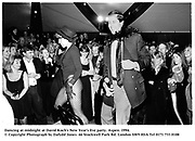 Dancing at midnight at David Koch's New Year's Eve party. Aspen. 1994.<br />© Copyright Photograph by Dafydd Jones<br />66 Stockwell Park Rd. London SW9 0DA<br />Tel 0171 733 0108