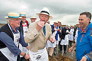 """08/09/2013 Singing to the Oysters<br /> <br /> To help wake the Native Oysters from their beds """"The Brook Singers"""", a male voice choir from Dublin, accompanied by Peter Caviston of Caviston's Food Emporium, (seen here enjoying one of the first of the season straight from the bay  opened by Diarmuid Kelly rhs )in Glasthule called to Kelly Oysters in inner Galway Bay.<br /> September is a busy month for the Native Oysters which have just come back into season.<br /> The singers will help the oysters prepare for the upcoming Galway international Oyster Festival at the end of the Month . As well as supplying the Oyster Festivals, Kelly Oysters supply oysters throughout Ireland and around the world.<br /> Last season these much sought after delicacies were exported to 14 different countries.   Photo: Andrew Downes"""