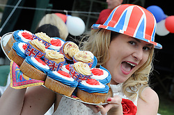 Orpington, UK  29/04/2011. The Royal Wedding of HRH Prince William to Kate Middleton..Street party,Hillview Crescent,Orpington,South East London, celebrating the Royal Wedding..Lucy Cobb (Resident)with her tray of cakes..Photo credit should read Grant Falvey/LNP.