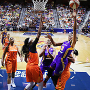 UNCASVILLE, CONNECTICUT- JULY 15:  Nneka Ogwumike #30 of the Los Angeles Sparks drives to the basket defended by Jonquel Jones #35 of the Connecticut Sun and Alyssa Thomas #25 of the Connecticut Sun during the Los Angeles Sparks Vs Connecticut Sun, WNBA regular season game at Mohegan Sun Arena on July 15, 2016 in Uncasville, Connecticut. (Photo by Tim Clayton/Corbis via Getty Images)