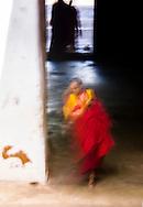 Monk shuffling through hallways, Wangdue Phodrang, Bhutan