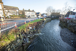 © Licensed to London News Pictures. 07/12/2015. Staveley UK. Picture shows collapsed bank on the river Gowan in Staveley. Police were called at 10 am on Sunday to reports that a man had fallen into the river Gowan ( a tributary to the river Kent ) at Staveley & officers along with the underwater search team located the body in the Kendal Area. Photo credit: Andrew McCaren/LNP