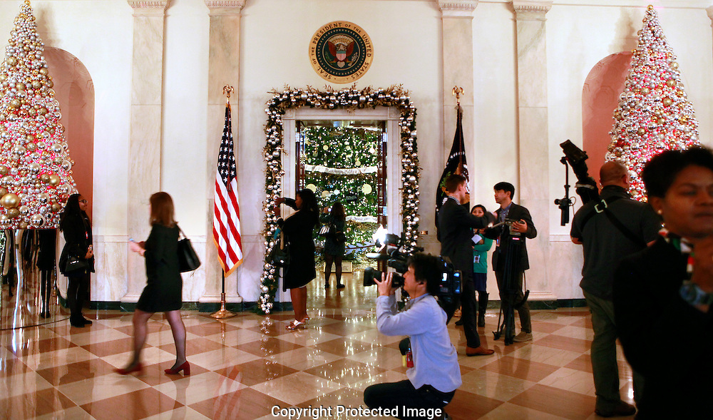 The media photographs the White House Christmas tree as part of the Christmas decorations at the White House  in December 2016<br /> <br /> Photo by Dennis Brack
