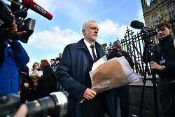© Licensed to London News Pictures. 23/03/2017. London, UK. Labour Party leader JEREMY CORBYN lays flowers on Westminster Bridge, the day after a lone terrorist killed 4 people and injured several more, in an attack using a car and a knife. The attacker managed to gain entry to the grounds of the Houses of Parliament, killing one police officer. Photo credit: Ben Cawthra/LNP