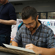 Business Design Centre, England, UK. 23rd August 2017. Gabriele Dell'Otto is an Italian illustrator artist signing comic book at the London Super Comic Convention 2017.