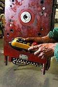 Reportage dans l'entreprise MGI Coutier, productrice de pièces automobile à Champfromier, Ain.