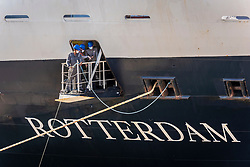 Crew members on the Holland America cruise ship Rotterdam, work to dock the ship at Port Everglades, in Fort Lauderdale, Thursday April 2, 2020. Holland America confirmed that the ship is carrying passengers infected with the coronavirus.