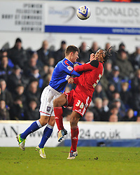 Ipswich Town's Aaron Cresswell catches Bristol City's Neil Danns in the face, but the foul is awarded agains Danns - Photo mandatory by-line: Joe Meredith/JMP  - Tel: Mobile:07966 386802 22/12/2012 - Ipswich Town v Bristol city - SPORT - FOOTBALL - Championship -  Ipswich - Portman Road -