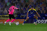 AFC Wimbledon defender Nesta Guinness-Walker (18) about to tackle Peterborough United attacker Siriki Dembele (10) during the EFL Sky Bet League 1 match between AFC Wimbledon and Peterborough United at Plough Lane, London, United Kingdom on 2 December 2020.