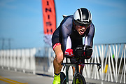 Time trial racer crosses the finish line