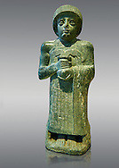 """Diorite statue of Guidea who ruled Lagash from around 2150 BC. The statue called the """"gushing vase"""" dedicated to the goddess Geshtinanna. From the ancient Sumarian city of Lagash. .<br /> <br /> If you prefer to buy from our ALAMY PHOTO LIBRARY  Collection visit : https://www.alamy.com/portfolio/paul-williams-funkystock  Type -    Lagesh  - into the LOWER SEARCH WITHIN GALLERY box to refine search by adding background colour, place, museum etc<br /> <br /> Visit our ANCIENT WORLD PHOTO COLLECTIONS for more photos to download or buy as wall art prints https://funkystock.photoshelter.com/gallery-collection/Ancient-World-Art-Antiquities-Historic-Sites-Pictures-Images-of/C00006u26yqSkDOM"""