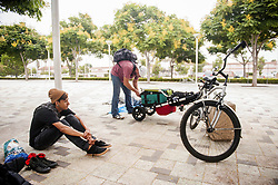 August 7, 2017 - Tustin, CA, USA - Richard Gerber, 42, packs up his bicycle, right, as Peter Frias, 20, waits at the civic center in Tustin, CA on Monday, August 7, 2017. The city posted signs at the civic center telling people living in the homeless encampment that they must move out by 8 a.m. to make way for a temporary library. (Credit Image: © Ken Steinhardt/The Orange County Register via ZUMA Wire)