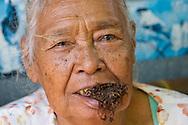 Elderly woman chewing tobacco at the Ngasem Bird Market, Yogyakarta, Central Java, Indonesia.