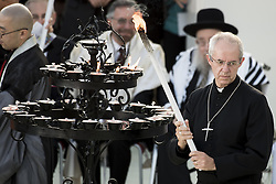 September 20, 2016 - Assisi, Umbria, Italy - Canterbury Archbishop Justin Welby lights a candle during the closing event of an inter-religious prayer gathering, in front of the Basilica of St. Francis, Assisi, Italy, Tuesday, Sept. 20, 2016. (Credit Image: © Massimo Valicchia/NurPhoto via ZUMA Press)