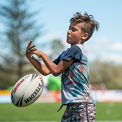 BRISBANE, AUSTRALIA - MARCH 18: A junior attempts to catch the ball during the NRL Development Junior Clinic and QRL training session at Ron Stark Oval on March 18, 2017 in Brisbane, Australia. (Photo by Patrick Kearney/Wynnum Manly Seagulls)