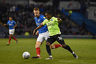 Portsmouth Midfielder, Tom Naylor (7) and Peterborough United Midfielder, Siriki Dembele (10) during the EFL Sky Bet League 1 match between Portsmouth and Peterborough United at Fratton Park, Portsmouth, England on 30 April 2019.