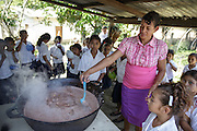 A woman prepares lunch for school children at the primary school in the town of Coyolito, Honduras on Wednesday April 24, 2013.
