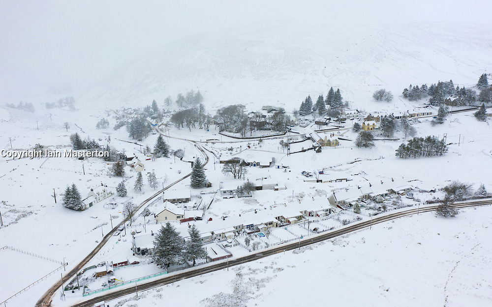 Wanlockhead, Scotland, UK. 27 December 2020. Heavy snow falls on Scotland's highest village of Wanlockhead in Dumfries and Galloway. Pic; aerial view of village in the now.  Iain Masterton/Alamy Live News