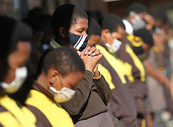 South Africa - Durban - 23 June 2020 - Pupils at Masijabule High school in Swayimane, outside Pietermaritzburg pray as they are about to be dismissed from school after some of the teachers from the school travelling with a staff taxi were attacked by an uknown gunmen on their way to school on Tuesday morning, where a driver of the staff taxi died at the scene<br /> Picture: Doctor Ngcobo/African News Agency(ANA)