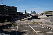 Empty area of the wholesale markets precinct, which is partially used as a parking lot, in Birmingham city centre, which is virtually deserted under Coronavirus lockdown on 5th May 2020 in Birmingham, England, United Kingdom. Coronavirus or Covid-19 is a new respiratory illness that has not previously been seen in humans. While much or Europe has been placed into lockdown, the UK government has put in place more stringent rules as part of their long term strategy, and in particular social distancing.
